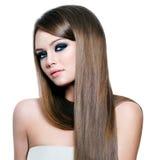 lång rak kvinna för härligt hår Fotografering för Bildbyråer