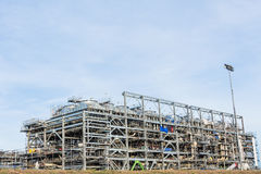 LNG Refinery Factory. Assembling of liquefied natural gas Refinery Factory with LNG storage tank using for Oil and gas industry background Stock Photo