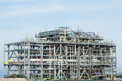 LNG Refinery Factory - Stock Image. Assembling of liquefied natural gas Refinery Factory with LNG storage tank using for Oil and gas industry background Royalty Free Stock Images