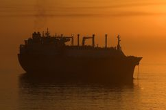 LNG ship anchorage silhouette- Royalty Free Stock Photo