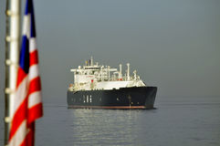 LNG ship for natural gas. LNG carrier ship designed for transporting natural gas anchored with liberian flag Stock Image