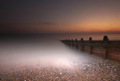 lång solnedgång Arkivbild