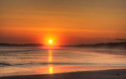 lång solnedgång för strand Royaltyfria Foton