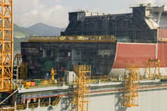 LNG tanker in shipyard. New building LNG tanker in dry dock with cranes on background Royalty Free Stock Photos
