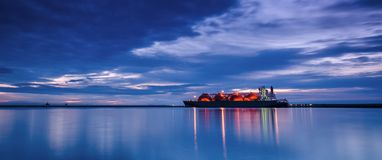 LNG TANKER. Sunrise over the sea gas terminal Stock Image