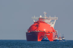 LNG TANKER AND TUGS Stock Photography