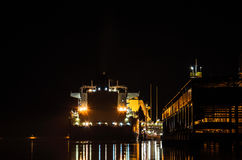 LNG TERMINAL AND GAS TANKER  AT NIGHT Royalty Free Stock Photo