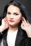 Långt hår för härlig brunettkvinna Arkivfoto