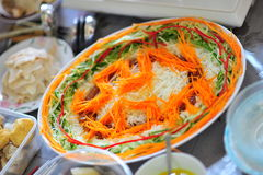 Lo Hei, a dish of tossed salad Royalty Free Stock Image