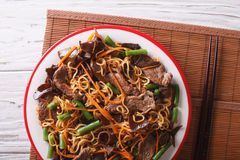Lo mein with beef, muer and vegetables closeup. Horizontal top v Stock Images