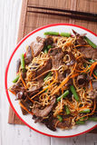 Lo mein with beef, muer and vegetables closeup. vertical top vie Royalty Free Stock Photos