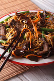 Lo mein Chinese noodles with beef and muer macro. Vertical Royalty Free Stock Photos