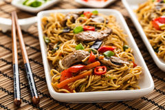 Lo mein. With vegetables, mushrooms and soy filets royalty free stock images