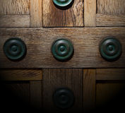 In lo ndon antique brown door  rusty  brass nail and light Royalty Free Stock Images