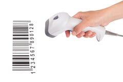 Lo scanner manuale del codice a barre in una mano femminile Fotografie Stock Libere da Diritti