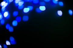 Lo scintillio blu accende il fondo defocused immagine stock libera da diritti