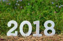 Lo scintillio d'argento numera un fondo da 2018 nuovi anni Fotografie Stock Libere da Diritti