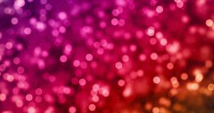 Lo scintillio digitale di Natale scintilla il multi bokeh delle particelle di colore che circola sul fondo variopinto, buon anno  royalty illustrazione gratis
