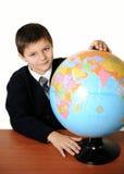 Lo scolaro con il globo Fotografia Stock