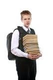 Lo scolaro con un pacchetto enorme dei libri Immagine Stock Libera da Diritti