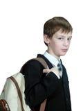 Lo scolaro con uno zaino Fotografie Stock