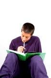 Lo scolaro del Pakistan sta studiando Immagine Stock