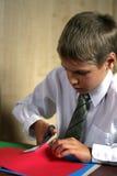 Lo scolaro l'addestramento labour dei passaggi dell'adolescente Fotografia Stock