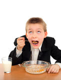 Lo scolaro mangia Fotografia Stock