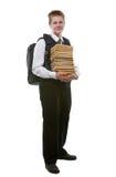 Lo scolaro in un uniforme scolastico con un pacchetto enorme Fotografia Stock Libera da Diritti