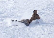 Lo Snowboarder è caduto nella neve Immagine Stock Libera da Diritti