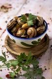 Lo Spagnolo caracoles la salsa dell'en, lumache cucinate in salsa immagini stock
