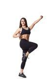 Lo sport helthy della donna atletica di forma fisica ha isolato la lotta bianca dei vestiti del nero del fondo Immagini Stock