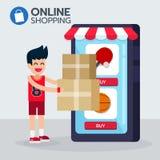 Lo sportman felice ottiene l'ordine della scatola dall'applicazione di commercio elettronico che compera online Fotografia Stock Libera da Diritti