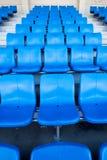 Lo stadio ed il sedile blu Fotografia Stock