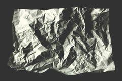 lo strato di bianco ha sgualcito la carta su fondo grigio Fotografie Stock