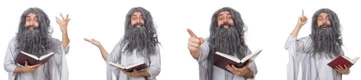 Lo stregone anziano divertente con il libro fotografia stock