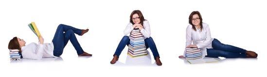 Lo studente con i libri isolati su bianco Fotografie Stock Libere da Diritti