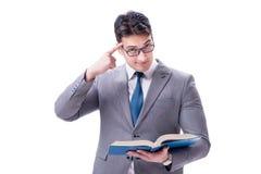Lo studente dell'uomo d'affari che legge un libro isolato sul fondo bianco Immagini Stock Libere da Diritti