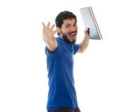 Lo studente di college felice e divertente sta tenendo un libro con il grande sorriso Fotografia Stock