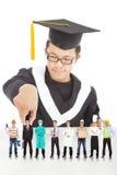 Lo studente di graduazione sceglie la sua carriera in futuro Immagine Stock
