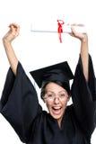 Lo studente di laurea mette il diploma sopra la testa Fotografia Stock Libera da Diritti