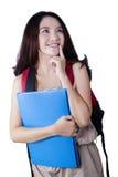 Lo studente femminile della High School pensa un'idea Fotografie Stock