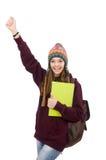Lo studente sorridente con lo zaino ed il libro isolati su bianco Fotografia Stock