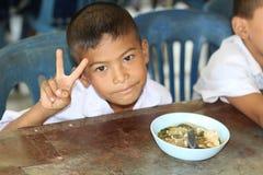 Lo studente tailandese è gode di fotografie stock