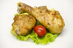 Lo studio arrostito delle coscie di pollo ha sparato fotografie stock