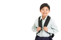 Lo studio ha sparato del ragazzo cinese in uniforme scolastico Fotografia Stock