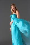Lo studio ha sparato della donna in vestito da sera blu Fotografia Stock Libera da Diritti