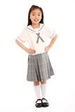 Lo studio ha sparato della ragazza cinese in uniforme scolastico Immagini Stock
