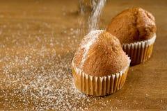 lo zucchero spruzza il bigné Fotografia Stock