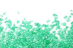 Lo zucchero verde spruzza su bianco Fotografia Stock